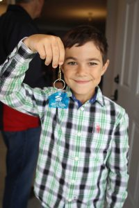 Leacross Landing Tereza's son Chayse shows off the keys to their new home.